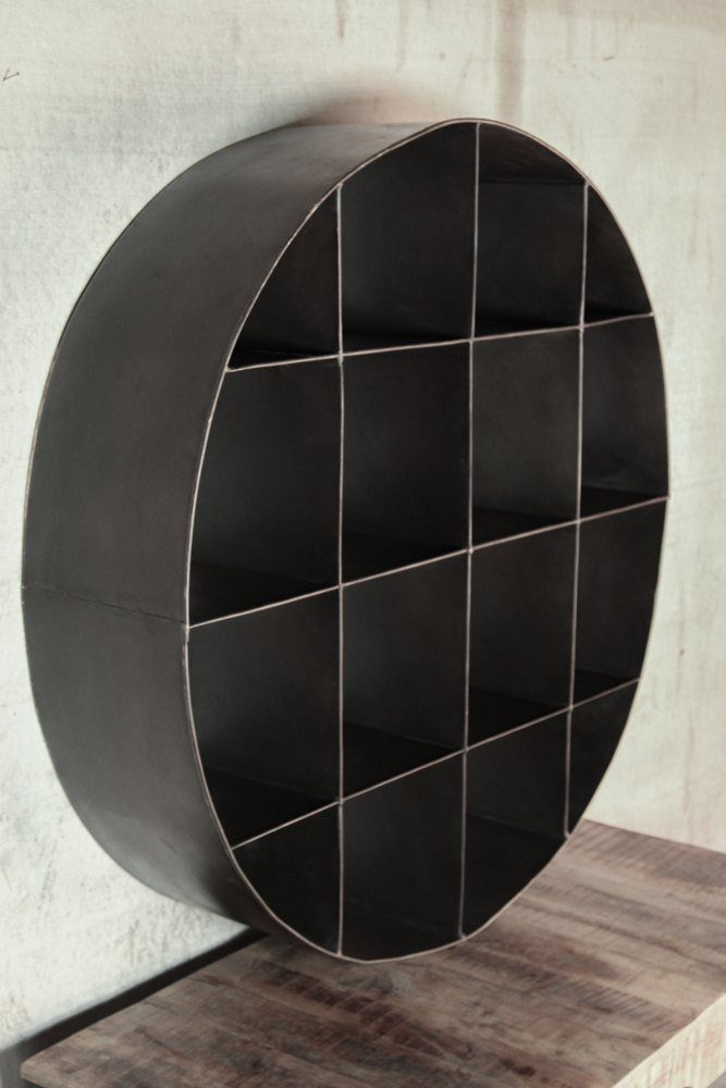 Circular industrial metal bookcase