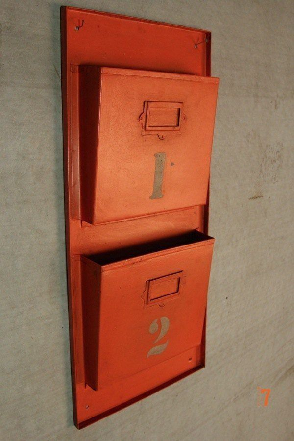Orange industrial magazine rack