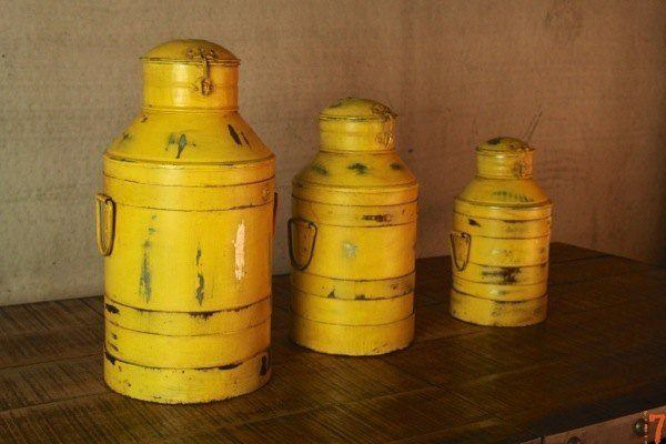 Set of 3 yellow antique milk churns