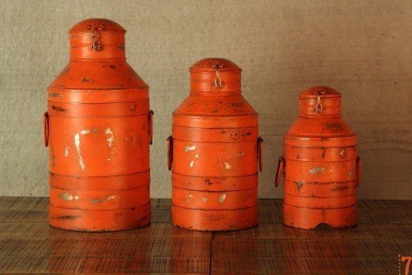 Set of 3 orange antique milk churns