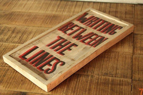 """Writing between the lines"" wooden sign"
