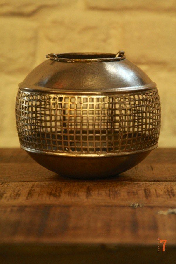 Round industrial metal candle holder
