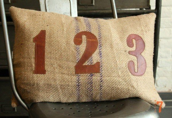 "Hessian cushion with leather ""123"""