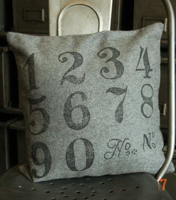 Grey square cushion with printed numbers