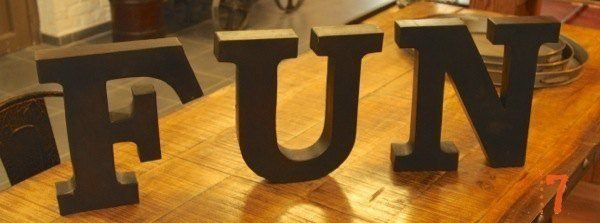"Large industrial metal letters ""FUN"""