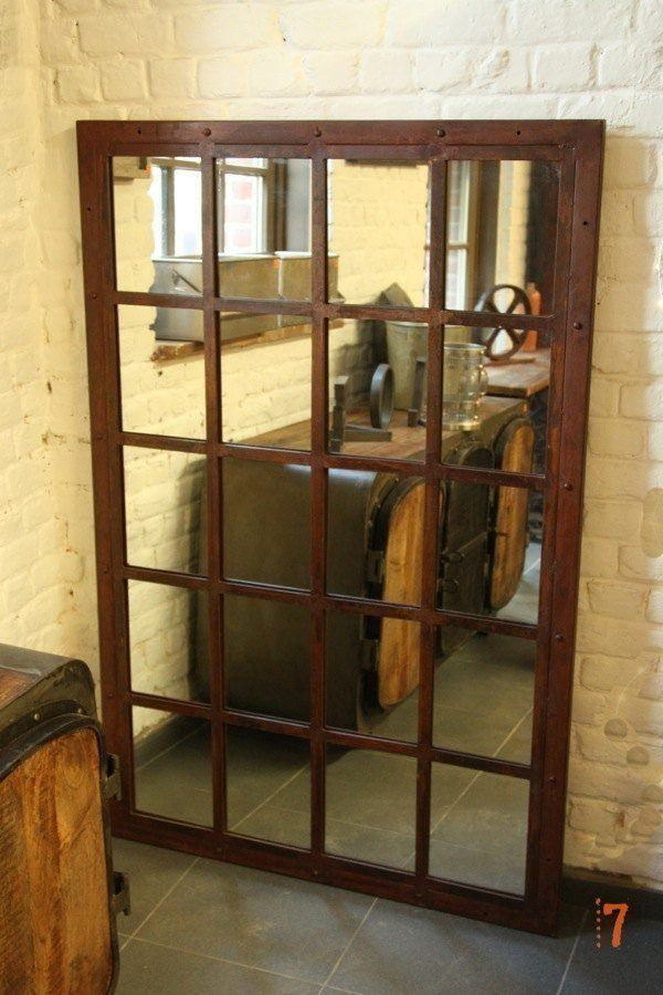 Large industrial mirror with rusty finish