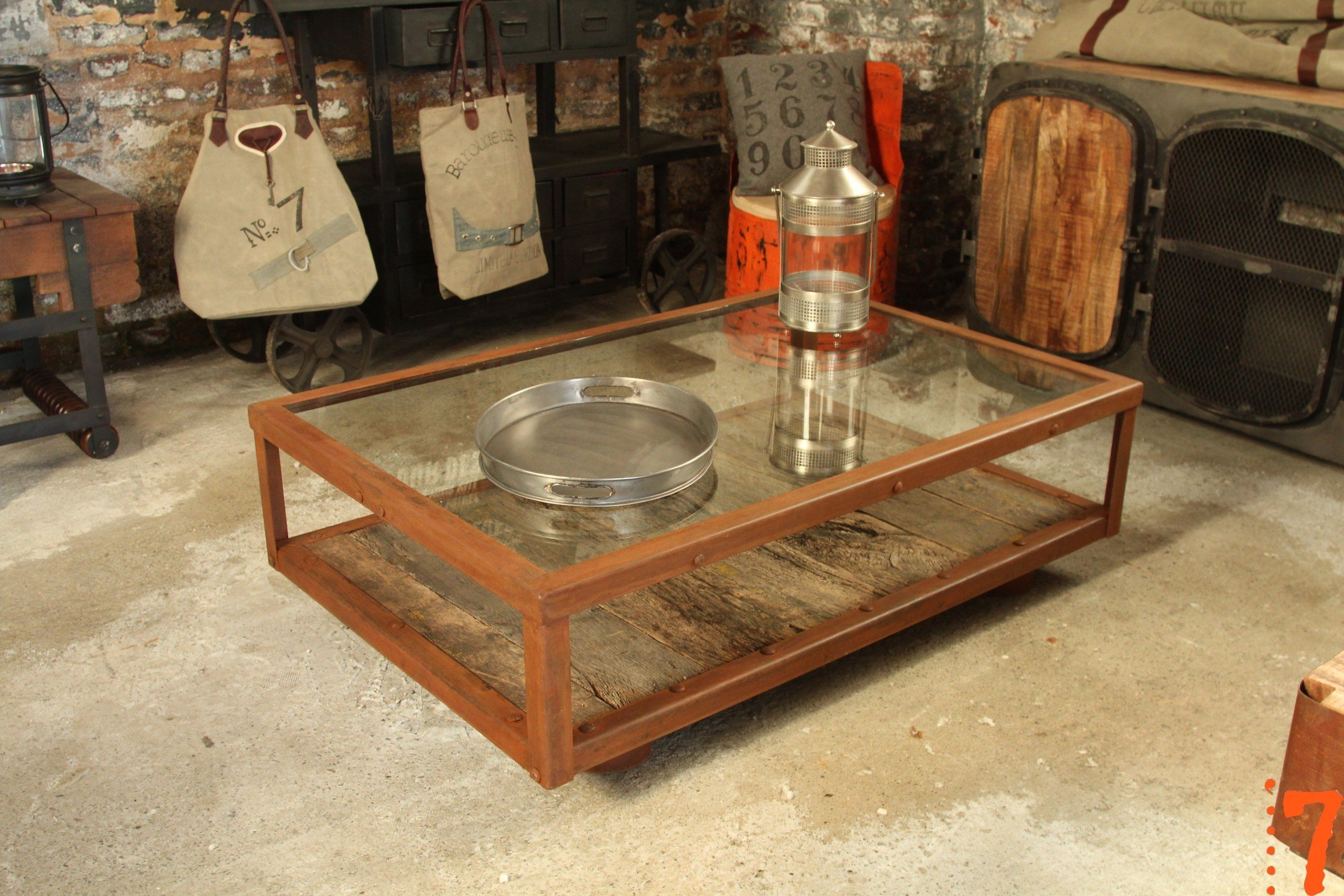 Industrial glass and wood coffee table, with casters