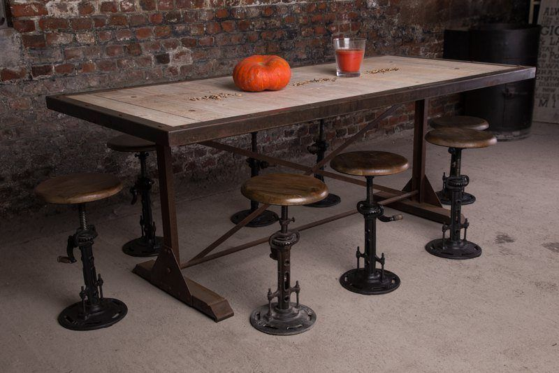Industrial dining table with rusty finish
