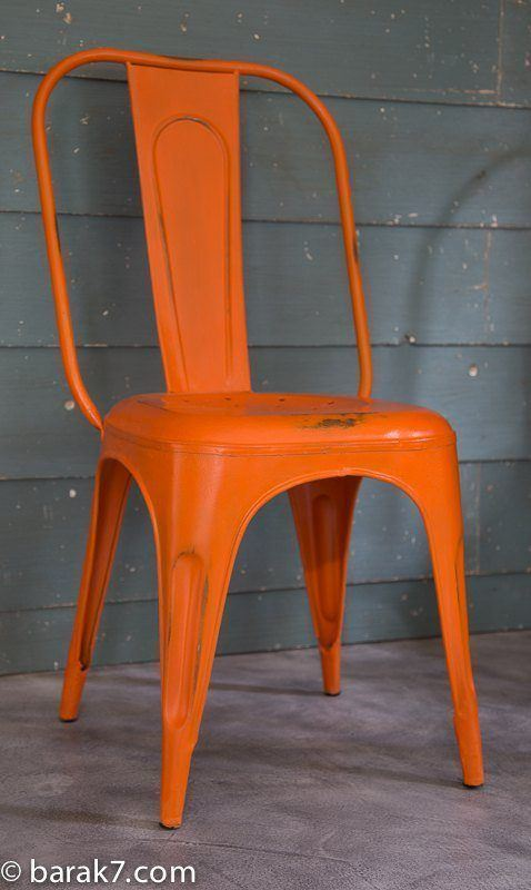 Industrial orange metal chair