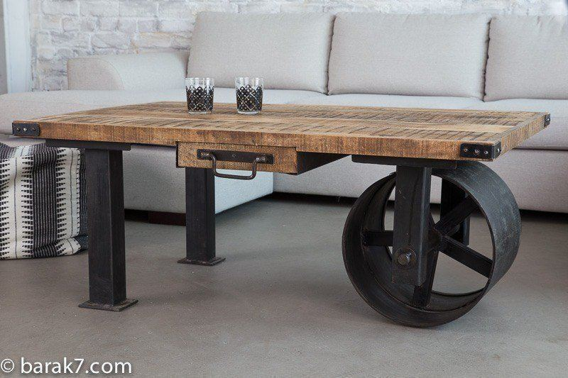 Industrial coffee table with large black wheel