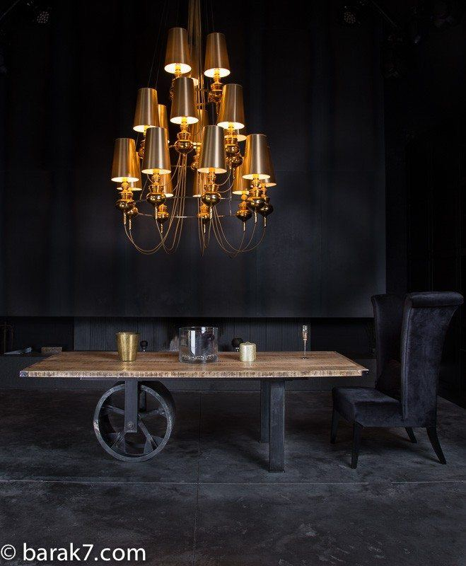 Industrial table with large black wheel