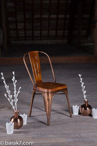 Industrial chair in coppered metal and leather