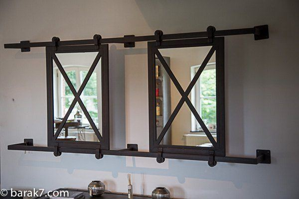 Industrial mirror with sliding panels